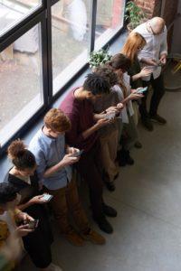 people-holding-their-phones-carl todd clinics-corsham swindon osteopathy massage