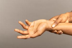 Women holding damaged wrist